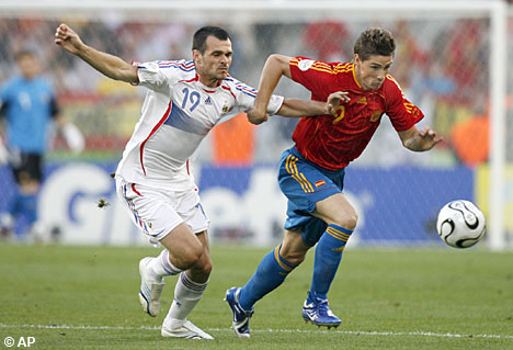 Sagnol (left) up against Spain's Fernando Torres at the 2006 World Cup in Germany